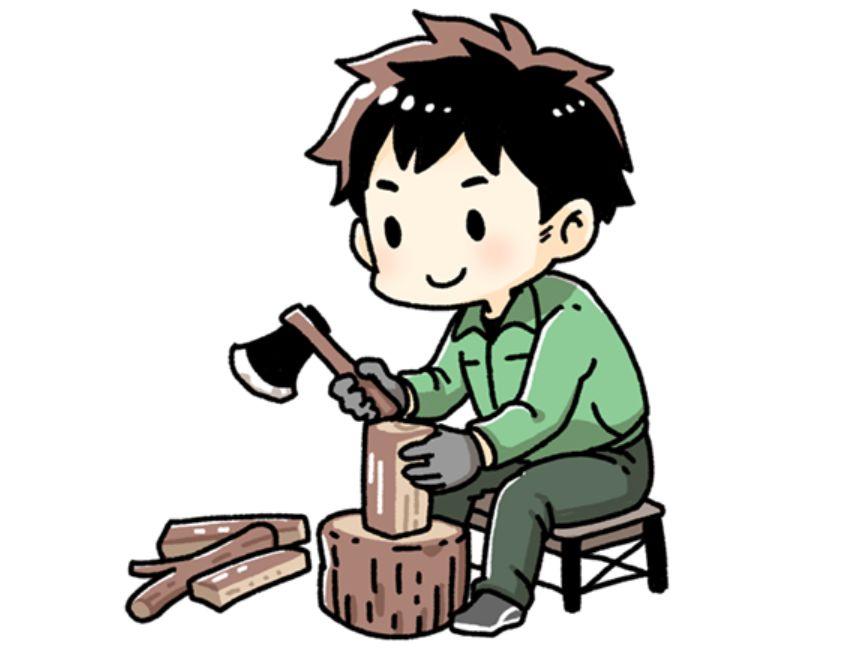 薪を割る男性